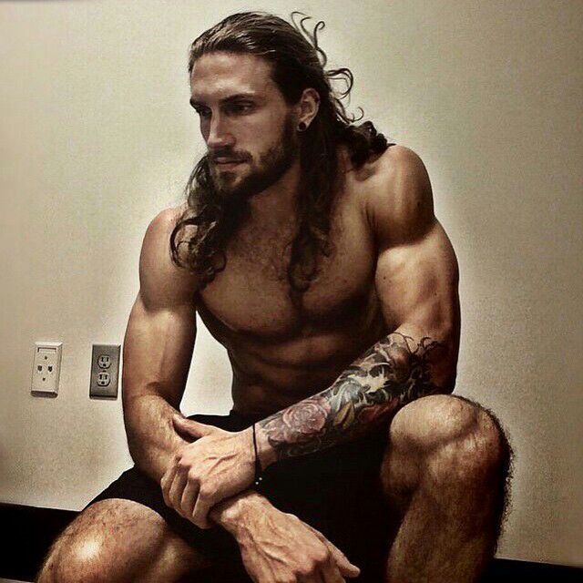from Alexander gay men with long hair and tattoos
