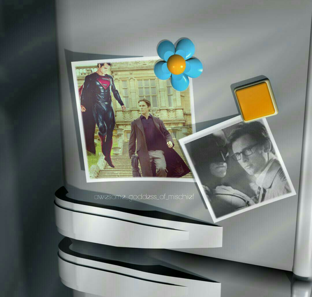 Two pictures on a fridge, one of Bruce Wayne and Superman, and one of Batman and Clark Kent